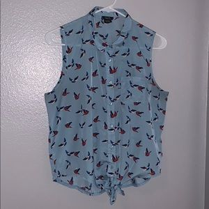 Blue sleeveless blouse with birds